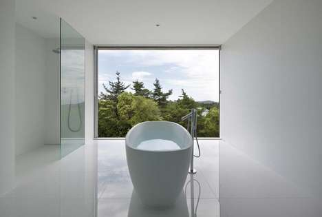 Minimalist White Bathrooms - Shinichi Ogawa & Associates Designs a Space with a Stunning Forest View