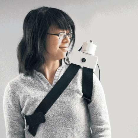 Shoulder-Perched Robots - The Grasp Telepresence Robot Whispers Instructions In Your Ear