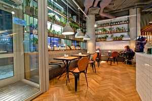 The Coffee Cake Cafe in Russia Boasts a Quaint Wooden Interior