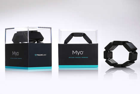 Glass-Encased Wearable Tech - The Myo Gesture Control Band is Packaged to Display Its Motion Focus