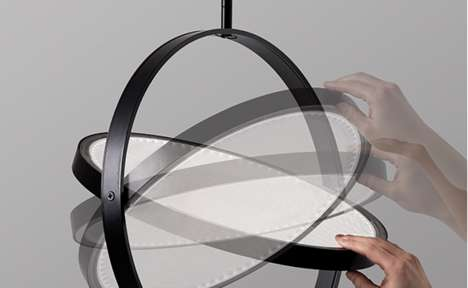 Pivoting Pendant Lamps - The Flip Light Rotates Within Its Rings to Adjust Direction and Diffusion