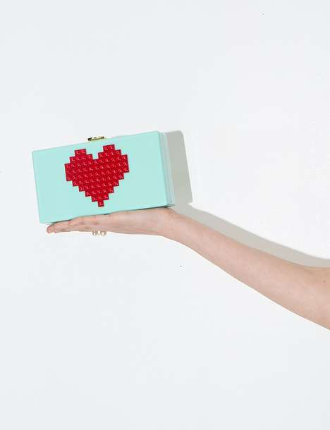 Romantic Gamer Accessories - Pixie Market's Heart Clutch Features a Pixelated Toy Design