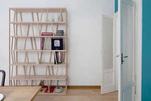The Paolo Cappello Tilta Bookcase Contains Space on Separate Ends