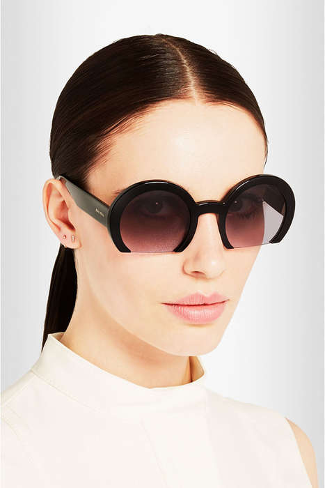 Half Moon Designer Shades - The Miu Miu Rasoir Model is a Contemporary Take on Jackie O's Style