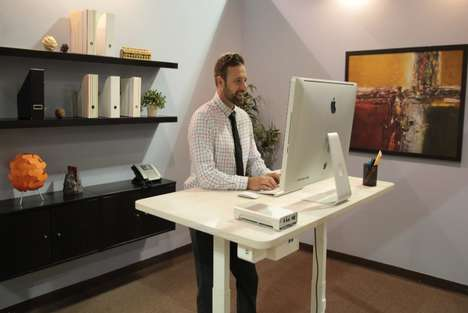 AI Office Furniture - This Robotbase Standing Smart Desk has a Built In Voice-Controlled Assistant
