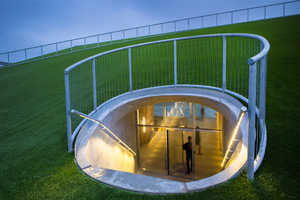 BIG Has Designed an Art Building Underneath This School Field