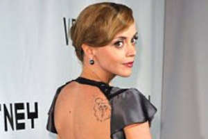 Christina Ricci Shows Off Tattoos in Versace