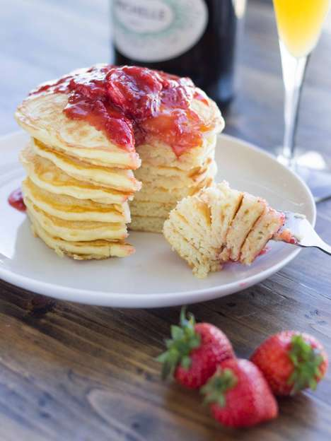 Champagne-Infused Pancakes - This Strawberry Champagne Pancakes Recipe Features Added Bubbliness