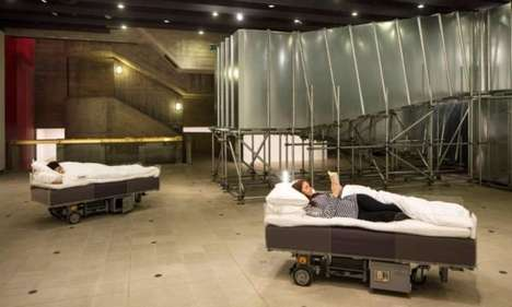 Robotic Bed Installations - Two Roaming Beds by Carsten Holler Carries Visitors Around the Exhibit