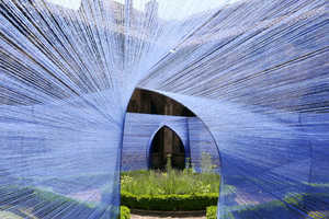 Atelier YokYok Designed this Whismsical String-Enclosed Walkway