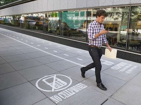Awareness-Raising Text Lanes - Antwerp's Text Walking Lanes Inform Pedestrians About Public Safety