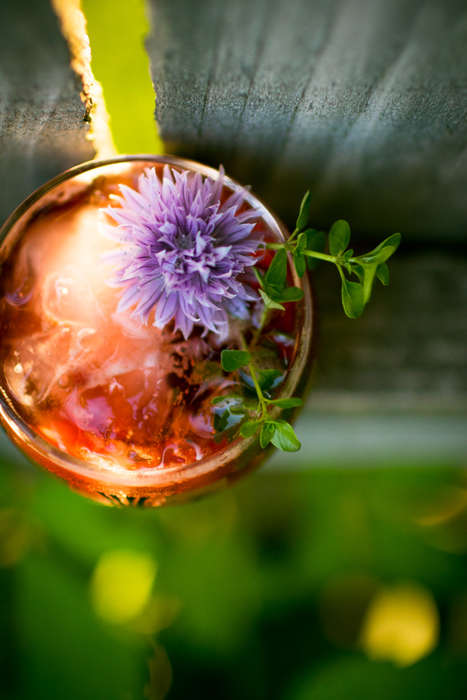Garden-Inspired Cocktails - This Floral Drink Combines Sweet Hibiscus Syrup and Fresh Edible Flowers