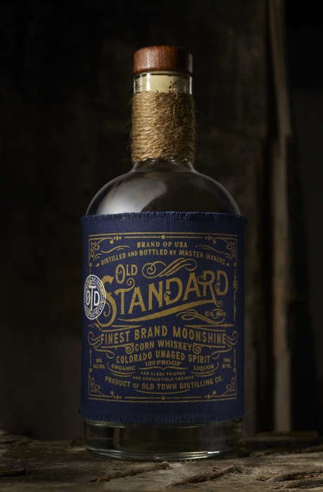 Embroidered Cloth Booze Branding - This Moonshine Bottle Features a Navy Blue Frayed Fabric Label