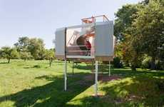 Ultramodern Treehouse Playgrounds - The Garrison Treehouse by Sharon Davis Sits in a Grassy Meadow