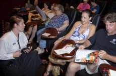 Dining Cinema Seats - The Movie Theater Seats at the 'Movie Tavern' Provide Folding Trays for Food