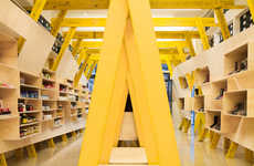 Exposed Pillar Shelves - This Retail Store Uses Bright Yellow Pillars and Wooden Shelving Displays