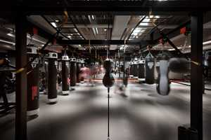This Moody Design-Focused Boxing Gym Resembles a Nightclub
