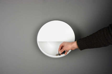 Illuminating Wall Shelves - This Circular Shelf is Mounted to the Wall as a Small Storage Space