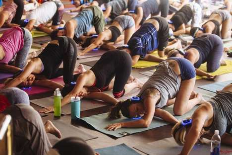 Headphone-Guided Yoga Sessions - 'Silent Savasana' Yoga Class Participants Wear Personal Headphones