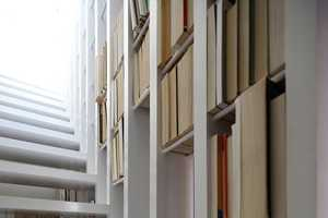 This Narrow Staircase Doubles as a Functional Bookshelf