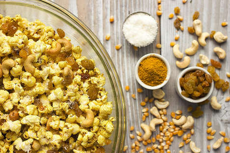 Curry Popcorn Mixtures - The Snack Mix Consists of Curry, Coconuts, Cashews, Raisins & Popcorn