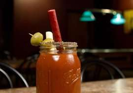 Meaty Cocktail Straws - This Decadent Bloody Mary is Topped With a Pepperette Drinking Straw