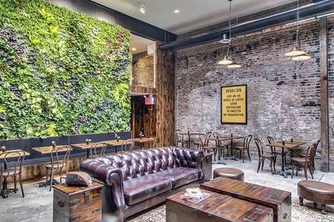 Cozy Eco Cafes - This Cafe Interior Features a Sustainable Green Wall Installation