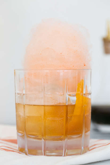 Colorful Carnival Cocktails - This Old Fashioned Recipe Incorporates a Topping of Cotton Candy