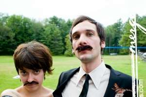 Bride and Groom Wear Matching Mustaches