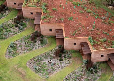 Seasonal Subterranean Shelters - This Rammed-Earth Wall Provides Housing for Temporary Workers
