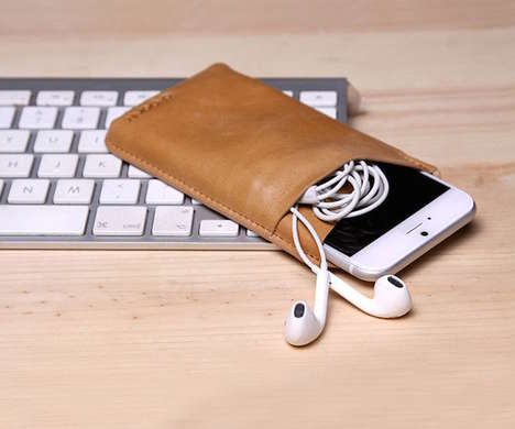 Compartmentalized Smartphone Sheaths - This Genuine Leather iPhone 6 Sleeve Has Room for More