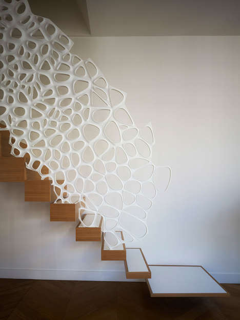 Sculptural Stair Railings - This White Banister Resembles a Lace Doily Cascading Down the Stairs