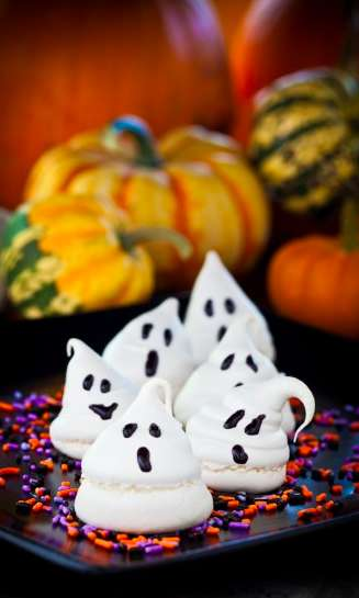 Ghostly Meringue Cookies - These White Meringue Peaks are Transformed into Spooky Halloween Ghosts