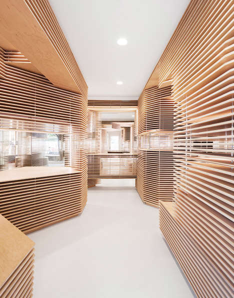 Asymmetrical Wooden Boutiques - This Store Interior is Filled with Layers of Floating Timber Slabs