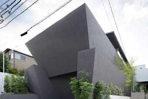 This Tokyo Residence is Encased Inside a Series of Huge Black Concrete Walls