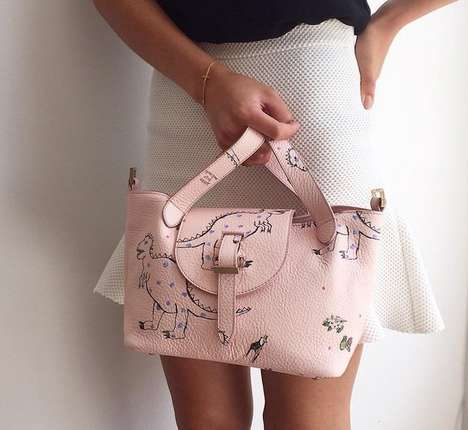 Pastel Dinosaur Purses - This Stylish Pink Tote Features a Stylish Extinct Reptile Print