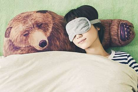 Huggable Bear Pillows - This Comforting Pillow Resembles a Sleeping Bear with an Outstretched Paw