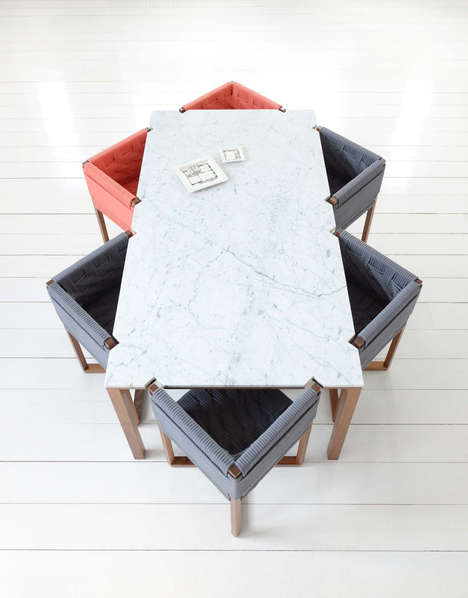 Notched Geometric Dining Tables - These Chairs Fit Snuggly into Notched Sections of Its Table