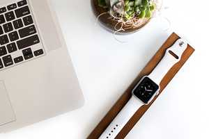 This Apple Watch Dock by OVA is Crafted From Rich Dark Maple Wood