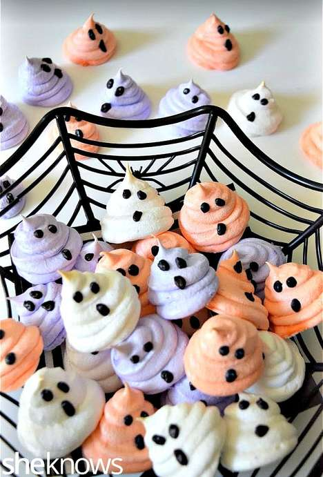 Festive Ghostly Mergingues - These Spooky Sweet Desserts are Decorated to Look Like Colorful Ghosts