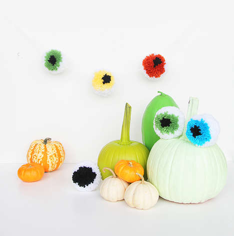 Spooky Eyeball Pom Poms - These Fluffy DIY Halloween Decorations Can Be Either Scary or Cute