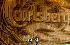 Laser-Cut Brand Logos - This Piece of Carlsberg Bar Art is Made of Laser-Sliced Pieces of Plywood
