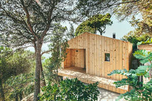 This Small Wooden House Doubles as a Studio for Its Owner