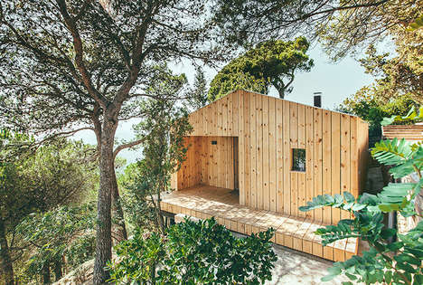 Wood-Cladded Tree Homes - This Small Wooden House Doubles as a Studio for Its Owner