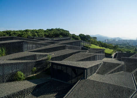 Zigzagging Art Galleries - This Folk Art Gallery Features Fragmented Roofs on a Sloping Hill