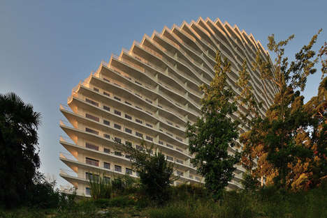 Wavy Sculptural Architecture - This Russian Resort Tapers to Create the Shape of an Arc