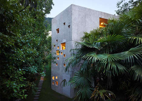 Archaic Stone Block Homes - This Concrete Home is Built into the Sloping Landscape