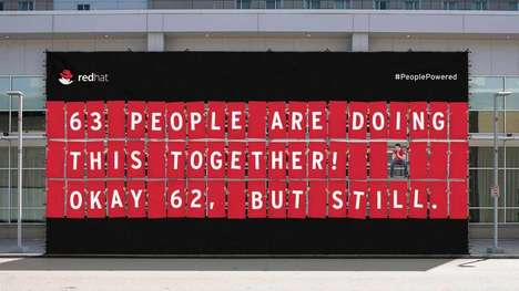 People-Powered Billboard Ads - 63 'Red Hat' Employees Built the Many Messages on This Billboard