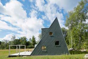 This Little Sloped-Wall Villa Is Made Out of Recycled Materials