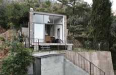 Glass-Paneled Microhomes - This Contemporary Cottage Features a Stone Facade and Glass Walls